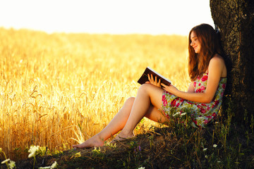 Young woman reading on nature