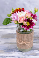 Beautiful bouquet of bright flowers in jar