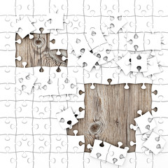 White Puzzle with Wooden Background