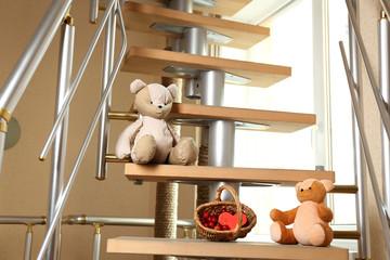Teddy bears on home stairs