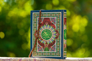 quran - holy book of Islam with rosery