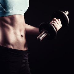 Fitness woman holding dumbbell