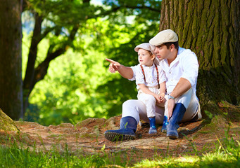 father and son together in forest