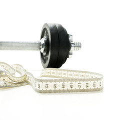 Tape measure and gym weight