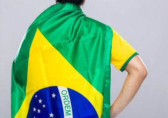 Backview of sportman wear with Brazil flag