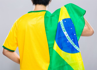 Brazilian football supporter hold with Brazil flag