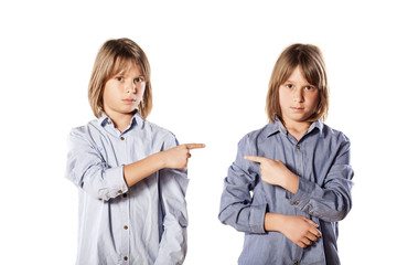 two twins brothers show the finger at each other
