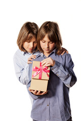 Twin brothers opened gift box