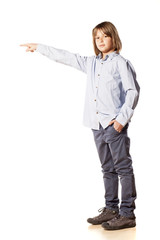 boy showing direction with his finger