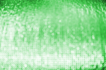 Abstract circular green bokeh background.