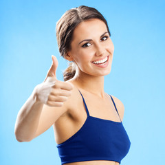 Woman in fitness wear, over blue