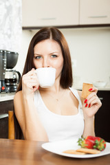 woman drinking tea with cookies