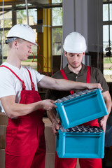 Production workers in protective workwear