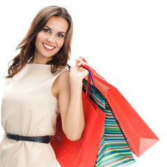 Young happy woman with shopping bags, isolated
