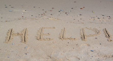 "Inscription ""HELP! "" on a sandy beach"