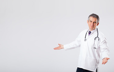 Doctor listening to empty copy space with stethoscope