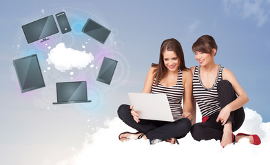 Young girls sitting on cloud enjoying cloud network service