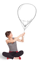 Pretty woman holding balloon drawing