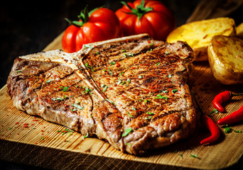 Grilled T-bone steak with vegetables