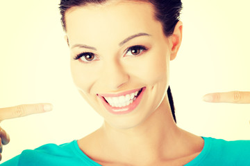 Woman showing her perfect white teeth.