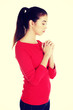 Young caucasian woman praying
