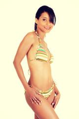 Portrait of dark skined girl in bikini