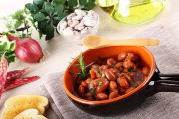 Bean soup in terracotta bowl