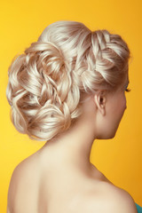 Hairstyle. Beauty Blond girl bride with curly hair styling over