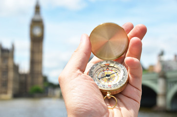 Compass in the hand against Big Ben in London