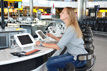 Girl in the bar with internet terminals