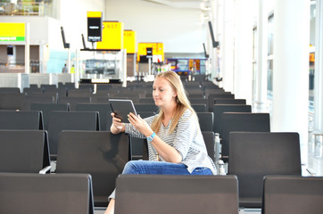 Girl with a tablet pc in the airport