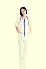 Nurse or young doctor standing smiling.