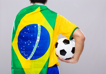Man with Brazil flag and hold soccer ball