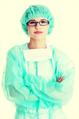 Portrait of happy young woman doctor