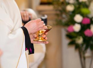 Catholic priest granting the Communion