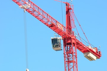Large red crane with cab