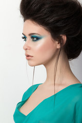 Portrait of beautiful girl in a turquoise dress
