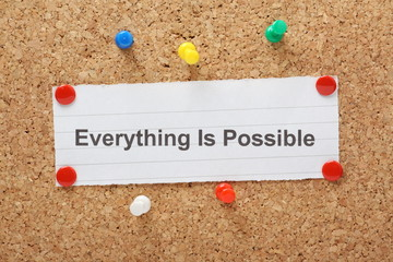 The phrase Everything Is Possible on a cork notice board