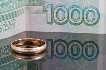 Golden wedding ring and thousand rubles