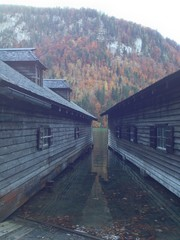 boat house reflection against an autumn tree background