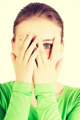 Shy or scared teenage girl