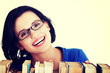 Happy smiling young student woman with books