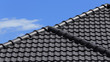 black tiles roof on a new house - 66215121