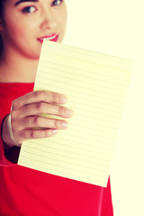 Young woman showing notepad