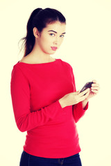 Young woman useing a modern mobile