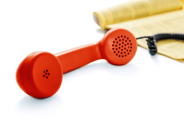 Red old phone and phone directory -Clipping Path