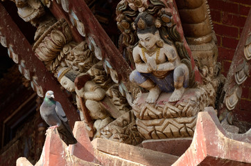 Hindu gods and dove - traditional wooden temple decoration,Nepal