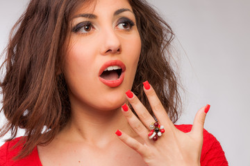 Surprised sexy girl with red dress