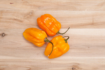chili habanero peppers on wooden table