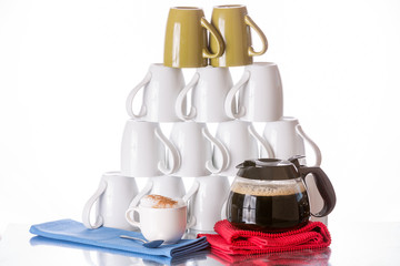 Stacked coffee mugs, fresh coffee and cappuccino
